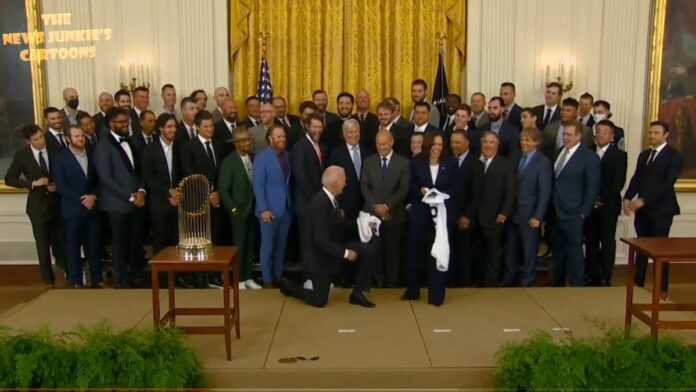 Why Does Biden Kneel When Taking a Photo with the LA Dodgers?