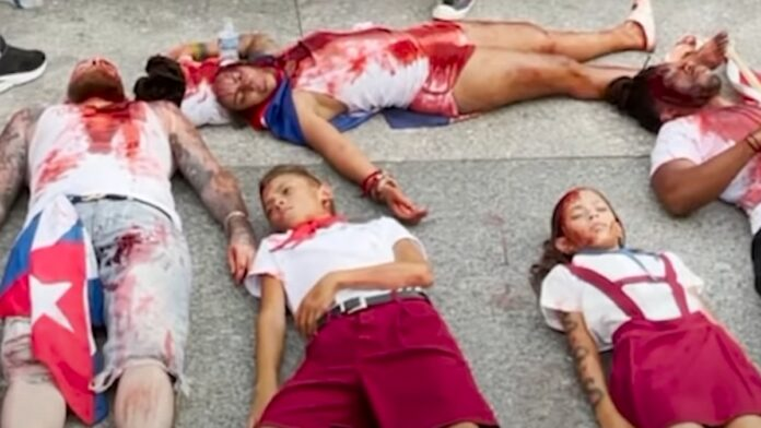 Must See: Cuba Protesters Covered in Blood at Die-In Outside the White House...